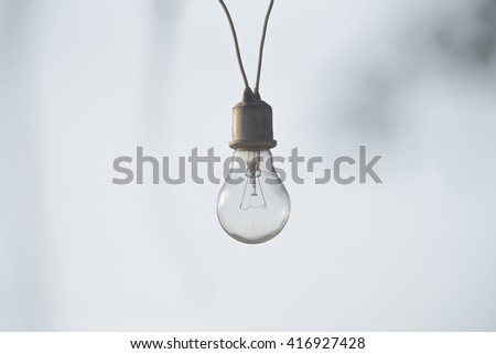 Light bulbs hanging on a electricity wire