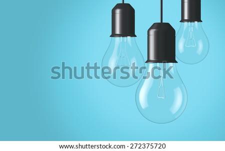 Light bulbs hanging on background - stock photo
