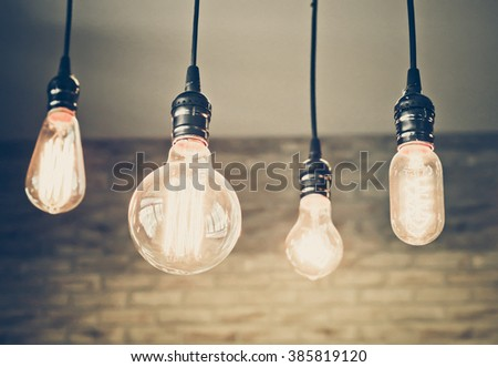light bulbs hung from the ceiling - stock photo