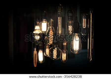 light bulbs in the dark - stock photo