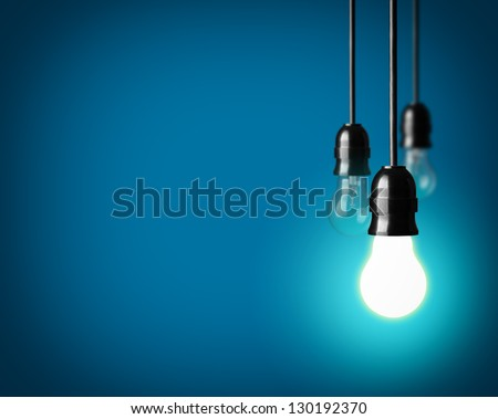 Light bulbs on blue background - stock photo