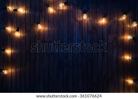 Light bulbs on dark Wooden Background real image - stock photo
