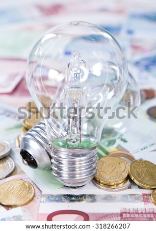 Light Bulbs on european banknotes (close-up shot)