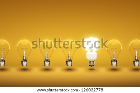 light bulbs on yellow ba?kground - stock photo