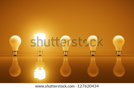 light bulbs on yellow background - stock photo