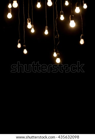 Light bulbs over dark texture - stock photo