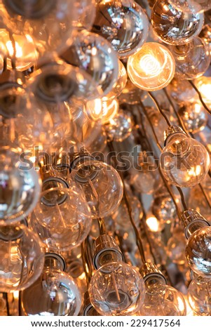 Light Bulbs, some on and some off - stock photo