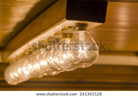 Light bulbs with base in a row. - stock photo