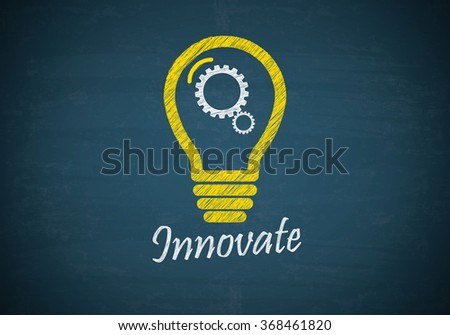 Light bulbs with Gear up and INNOVATE  text on blue chalk board , business concept , business idea - stock photo