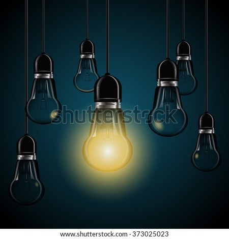 light bulbs with glowing  on dark blue background