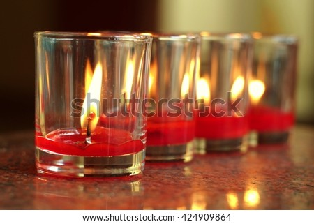 light candles in glass