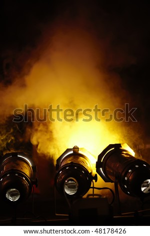 Light cannon and smoke at rock concert. Space for text. - stock photo