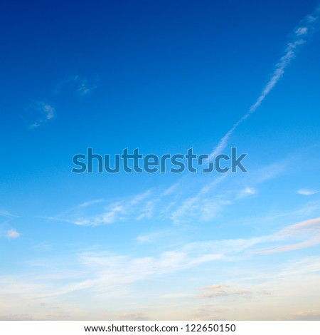 light clouds in the blue sky - stock photo