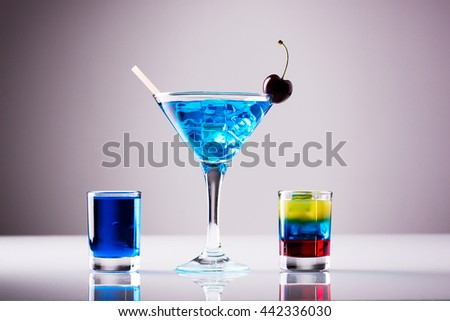 Light colored cocktails; blue curacao based shots - stock photo