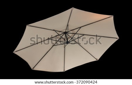 light-coloured of Umbrella isolated on black background. with clipping path - stock photo