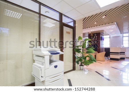 Light corridor near reception in business company with sofas and chairs. - stock photo