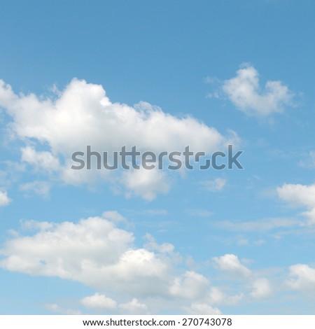 light cumulus clouds in the blue sky - stock photo