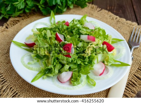 Light diet Spring salad of Chinese cabbage and radish. Vegan dish. - stock photo