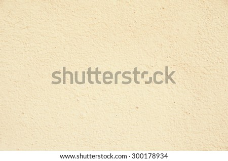 Light eggshell color  Cement wall - stock photo