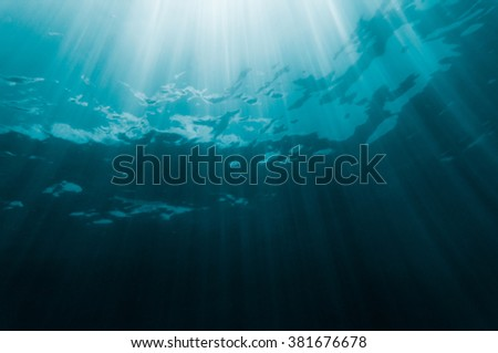 Light fall into the deep dark turquise ocean as background image - stock photo