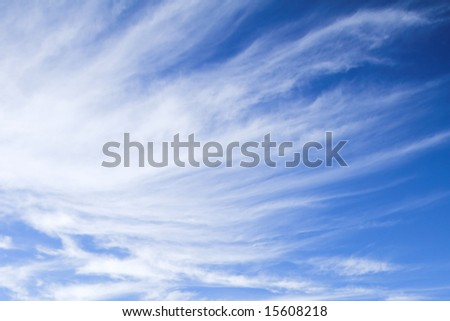 light fleecy clouds in the blue sky