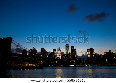 Light from buildings in Manhattan reflect on the river, New York
