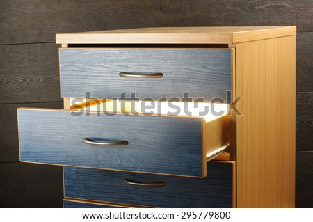 Light from open drawer - stock photo