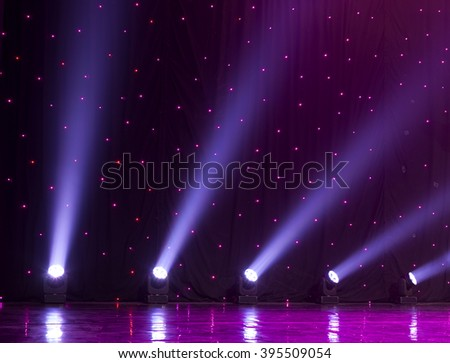 Light from the scene during the concert. light in the theater, a concert, a circus  - stock photo