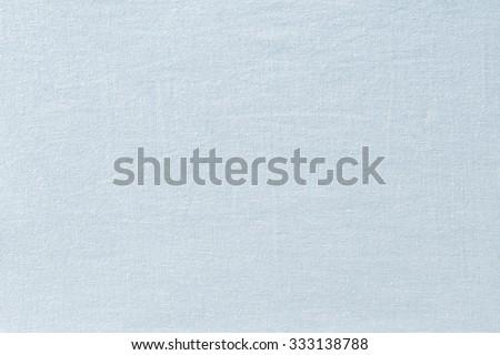 Light grayish blue fabric wallpaper texture background. - stock photo