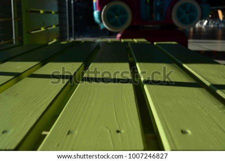 light green bench made of wood, parallel boards