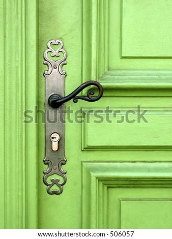 light green door with metal handle - stock photo