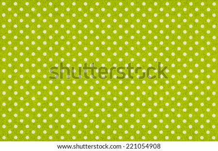 Light green fabric with white polka dots - stock photo
