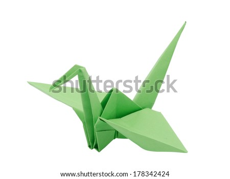Light Green origami paper crane. Isolated on white - stock photo