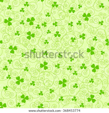 Light green St. Patrick's day background with swirls and clover leaves. - stock photo