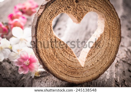 Light  heart on rustic wooden background - stock photo