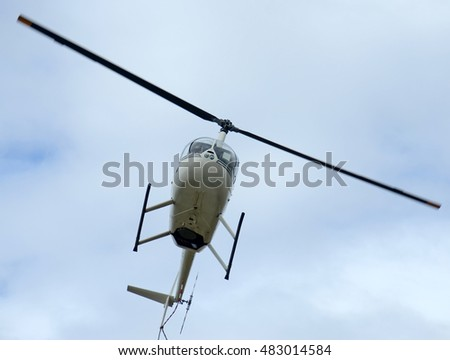Light helicopter in flight seen from below