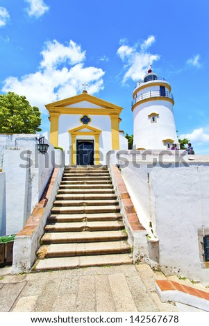 Light house and church in Macau, China. - stock photo