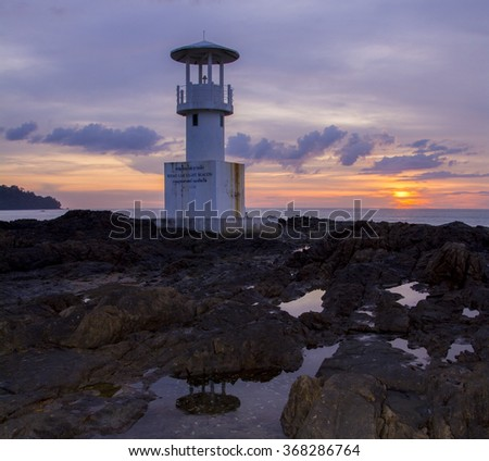 Light house and sunset - stock photo