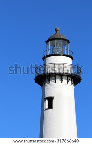 Light house, near Brunswick, Georgia on St. Simons Island, set against a blue sky.  Image is offset to allow for copy space.