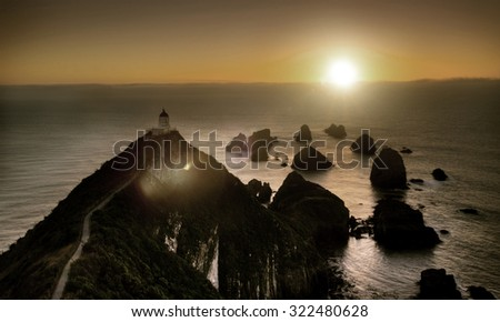Light House Nugget Points New Zealand Scenery Concept - stock photo
