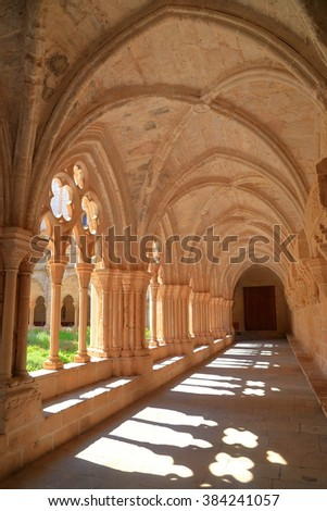 Light illuminates the cloister of the Royal Abbey of Santa Maria de Poblet (Poblet Monastery) in Catalonia, Spain