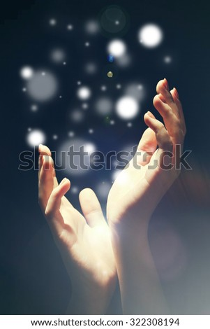 Light in human hands in the dark,  miracle concept