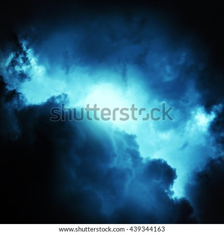 Light in the Dark and Dramatic Storm Clouds