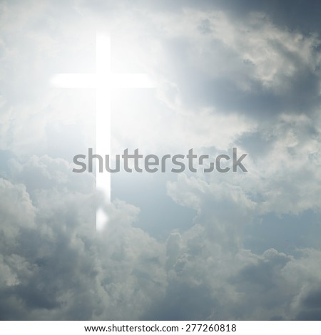 Light in the sky and the Christian cross - stock photo