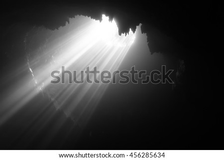 Light infiltrates and illuminates dark side of the cave
