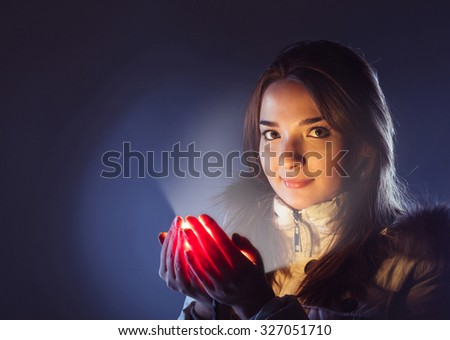 light into the palm of a beautiful girl - stock photo