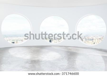 Light loft room with round windows and concrete floor 3D Render - stock photo