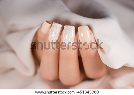 Light manicure in light on a white background. - stock photo