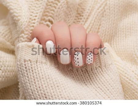 Light manicure on a white background. - stock photo