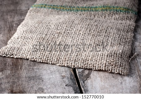 light natural linen texture on old table - stock photo